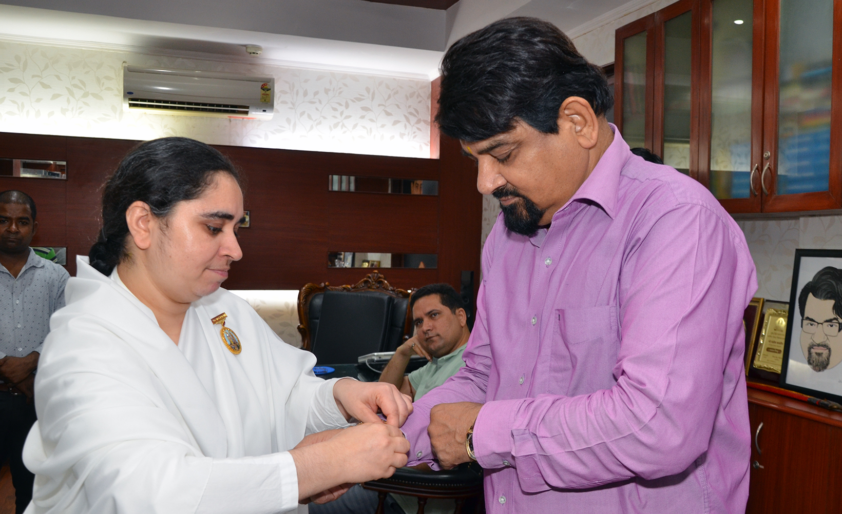 BK Aditi from Gyan Sarovar Mount Abu tying Rakhi to Mr. Santosh Bhartiya , Editor In Chief , Chauthi Dunia
