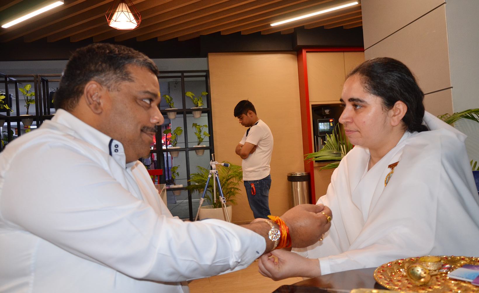 BK Aditi ties Rakhi to Supriya Prasad - Managing Editor Aaj Tak News Channel