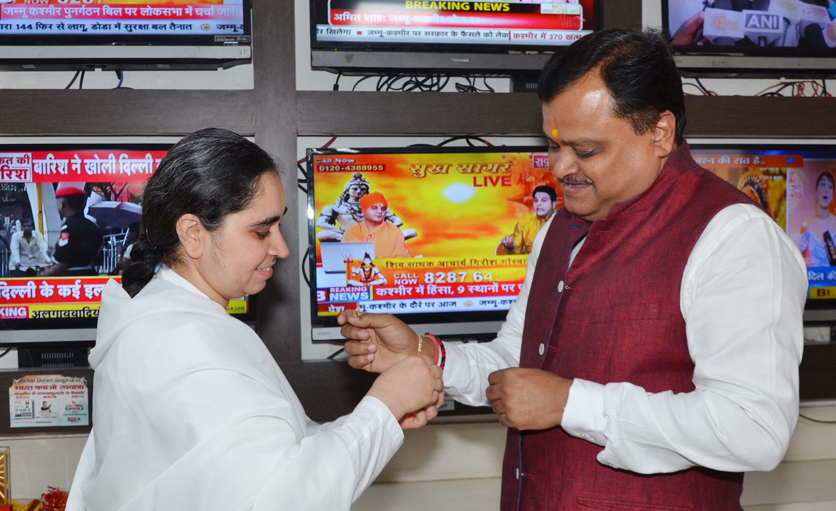 BK Aditi ties Rakhi to Mr. Suresh Chavhanke , Chairman & Managing Director Sudharshan TV Channels