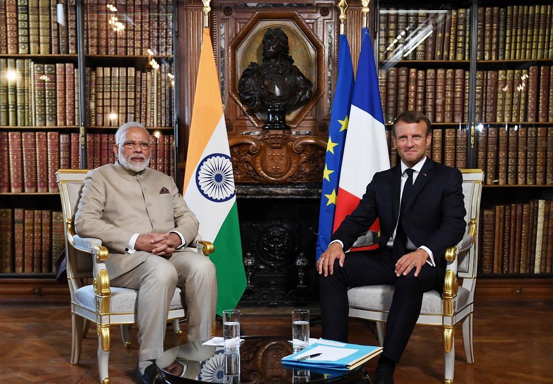 PM Modi reaches France, meets President Macron