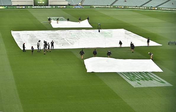 India take slender lead in rain-marred session
