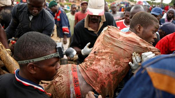 Zimbabwean rescuers pull out eight trapped miners alive