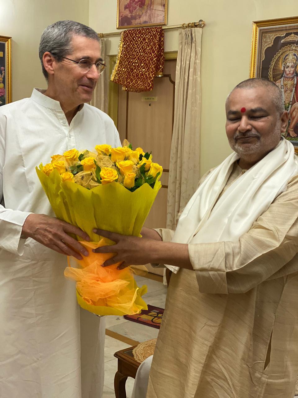 Brahmachari Girish ji honouring Raja Dr. Harris Kaplan ji